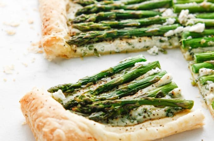 A slice of Creamy Herbed Ricotta and Asparagus Puff Pastry Tart is the perfect appetizer.